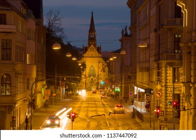 BRNO, CZECH REPUBLIC - APRIL 23, 2018: Church of Jan Amos Komensky (Red Church) in the evening city landscape