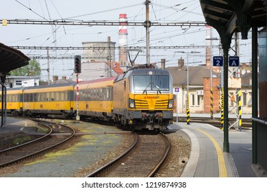 BRNO, CZECH REPUBLIC - APRIL 24, 2018: The passenger train of the RegioJet transport company arrives on the Brno railway station on a spring afternoon