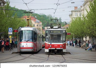 BRNO, CZECH REPUBLIC - APRIL 24, 2018: Two trams on a public transport stop on a spring day
