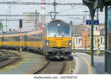 BRNO, CZECH REPUBLIC - APRIL 24, 2018: The yellow passenger train of the RegioJet company arrives to the railway station of the city of Brno