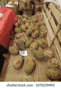 BRNO, CZECH REPUBLIC - CIRCA MARCH 2018: pineapple (Ananas comosus) aka Ananas fruit vegetarian food for sale in a African food market in Brno
