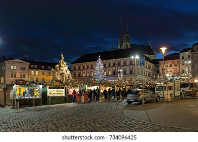 BRNO, CZECH REPUBLIC - DECEMBER 12, 2016: Christmas market on Zelny Trh (Vegetable market square) around Parnas fountain in evening. On the background is visible the Cathedral of St. Peter and Paul.