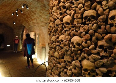 Brno, Czech Republic - February 24, 2017: Tourists explore the ossuary beneath St. James' Church in Brno, Czech Republic. The centuries-old skeletal remains of thousands of people occupy the crypt.