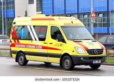 Brno, Czech Republic - July 22, 2014: Yellow ambulance car Mercedes-Benz Sprinter in the city street.