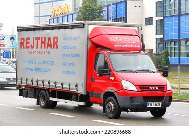 BRNO, CZECH REPUBLIC - JULY 22, 2014: Red cargo truck Iveco Daily at the city street.