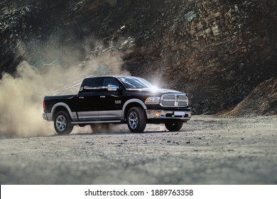 Brno, Czech Republic - June 15 2014: Dodge RAM 1500 with dust swirling from the quarry in which it is driving.