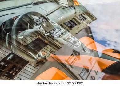 Brno, Czech Republic - june, 2018:  Orange Lamborgini is parked on a cobblestone street in historical center in Brno, Czech Republic. close up of cabin through the glass roof.