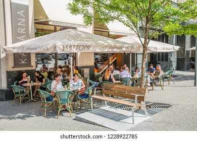 Brno, Czech Republic - june, 2018: cityscape. Tourists in a charming hotel restaurant terrace in the city center of Brno, Moravia, Czech Republic, Europe