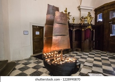 Brno, Czech Republic - june, 2018: inside Cathedral of St Peter and Paul - in Brno, Moravia, Czech Republic, Europe. close up of interior element: wooden ship with candels.