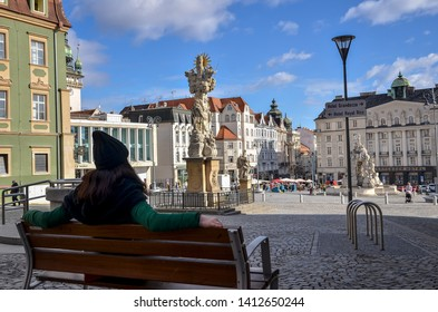 Brno, Czech Republic - March 11, 2019: Tourist girl overlooking Parnas Fountain  in the old town of Brno