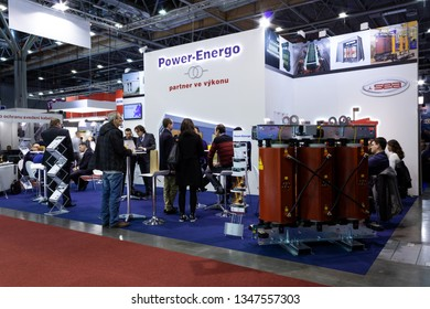 BRNO, CZECH REPUBLIC – March 20, 2019: Random photography shot of promotion at 27th International Trade Fair Amper 2019 of technologies in Brno exhibition centre, dry transformer on right side