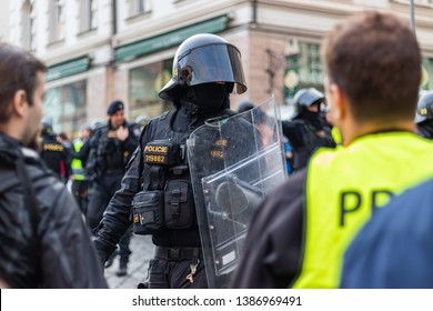 Brno, Czech Republic - May 1, 2019: Police officer in riot gear with shield during demonstration right-wing extremists and clashes with activists against radicalism. Protest on Labor Day in city