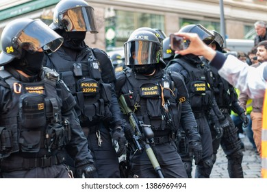 Brno, Czech Republic - May 1, 2019: Police officers in riot gear with weapons during demonstration right wing extremists and clashes with activists against radicalism. Protests on Labor Day in street
