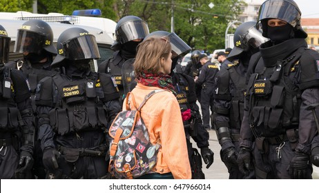 BRNO, CZECH REPUBLIC, MAY 1, 2017: Czech girl activist protest first may day against extremists. demonstration of radical extremists, against European Union, police unit oversees, Europe, EU