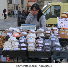 BRNO, CZECH REPUBLIC - NOVEMBER 2, 2015: woman is selling cereals on the street market in Brno, Czech