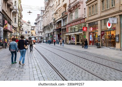 BRNO, CZECH - SEPTEMBER 25, 2015: tourists on Masarykova street in Brno city in morning. Masarykova is central pedestrian street in the old town.
