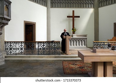 Brno, Czechia - 04/26/2020: Sermon of pastor Jiri Gruber of Evangelical Church of Czech Brethren in the empty Red Church (Church of Jan Amos Komensky) in Brno.