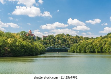 "Brno dam called ""Prygl or Prigl"" with Veveri castle on sunny summer day. Green trees around dam, blue sky, few white clouds. South Moravia, Czech republic, Europe"