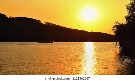 Brno dam. The city of Brno-Europe. Beautiful sunset by water with a boat.