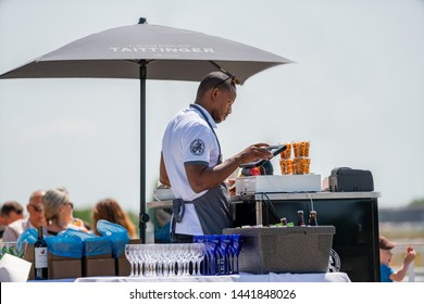 BRO, SWEDEN - JUNE 30, 2019: Close-up view of customers and staff at an outdoor restaurant with a drink stand in Bro Sweden June 30, 2019.