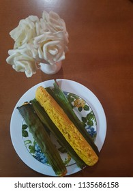 Broa made with corn and rolled in banana leaf. Typical of Brazil called a stick-a-pique broa