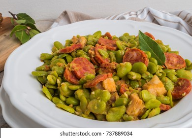 Broad bean with chorizo on vintage background. Typical portuguese food