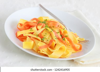 Broad egg noodles mixed with ribbons of carrot is a quick and easy dinner side dish and best of all, leftovers can be mixed with another vegetable or even tuna for lunch the next day