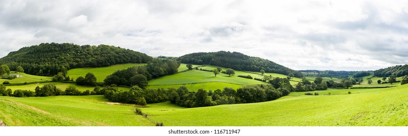 Broad panorama of the countryside in North Wales with green field in foreground