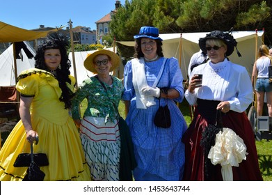 BROADSTAIRS, KENT/UK-JUNE 22 2019: Visitors enjoy the annual Dickens Festival, with costumed characters, re-enactments, music a market and the award winning beach.
