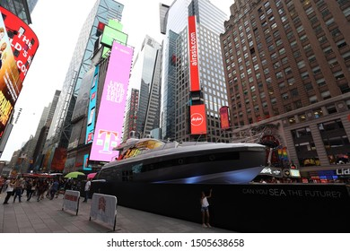 Broadway Avenue, New York/USA - 7th june 2019 : Advertising screens and a boat on Broadway avenue