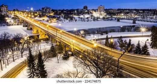The Broadway Bridge and South Saskatchewan River in Saskatoon, Canada on a cold winter night.