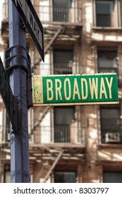 Broadway sign in front of apartment building