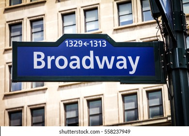 Broadway street sign with building background near 34th Street and Herald Square in Manhattan, New York City NYC