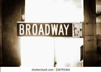 Broadway Street Sign in New York City, with Statue of Liberty