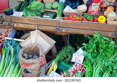 BROADWAY, UNITED KINGDOM - JUNE 12, 2014 - Vegetables displayed on an old cart outside a shop along High Street, Broadway, Cotswolds, Worcestershire, England, UK, Western Europe, jUNE 12, 2014.