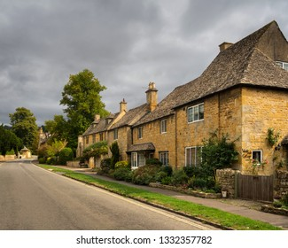 BROADWAY/WORCESTERSHIRE/ENGLAND-AUGUST/27/2018  Cotswold stone housed line the road going through the town of Broadway on a summers day