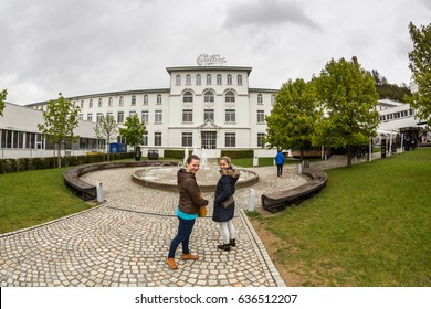 BROC, SWITZERLAND - MAY 1, 2017. View of two girls in front of the Maison du Cailler a chocolate factory from Nestle in Broc on May 1, 2017. Its popular by tourist for visiting the chocolate factory.