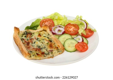 Broccoli and bacon savory tart with salad on a plate isolated against white
