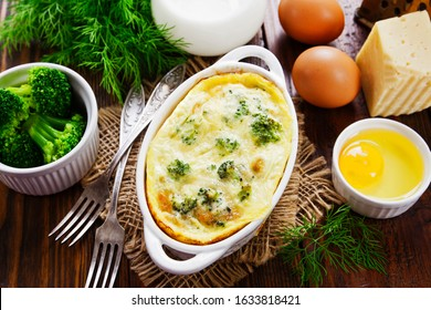 Broccoli baked with eggs and cheese in a ceramic pot