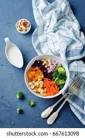 Broccoli carrot cashews apple salad with honey greek yogurt dressing. toning. selective focus