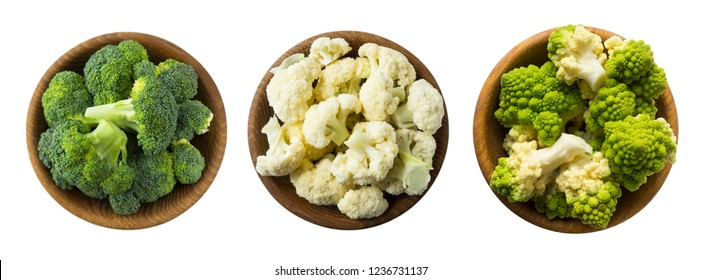 Broccoli, cauliflower and roman cauliflower in wooden bowl isolated on a white background. Vegetables with copy space for text. Three bowls of cabbage on a white background. Set of cabbage. Top view.