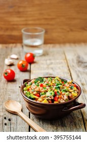 broccoli, corn, red pepper, green peas red and white rice. toning. selective focus