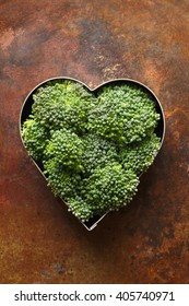 Broccoli florets fill the inside of a heart shape container