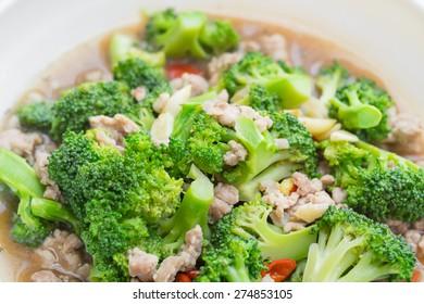 Broccoli fried on white dish