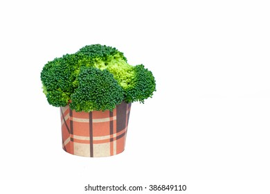 Broccoli in a glass of paper for table decoration, isolate on white background.