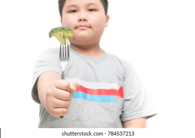 broccoli on hand obese fat boy isolated on white background, healthy food concept and copy space