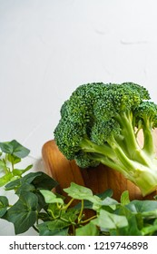 Broccoli on white wooden board