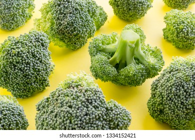 Broccoli on a yellow background. Fresh broccoli.
