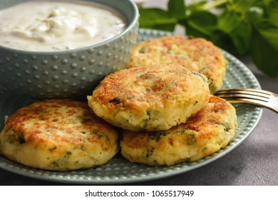 Broccoli and potato cutlets with cheese and yogurt dip.