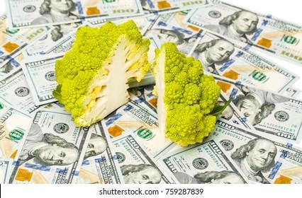 Broccoli Romanesco, or Roman cauliflower in a cut on dollar bills